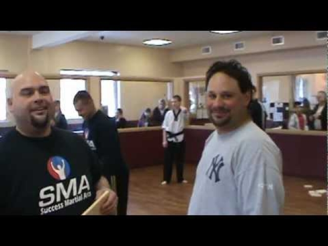 Raising money to fight bullying – Davin's head breaks wood